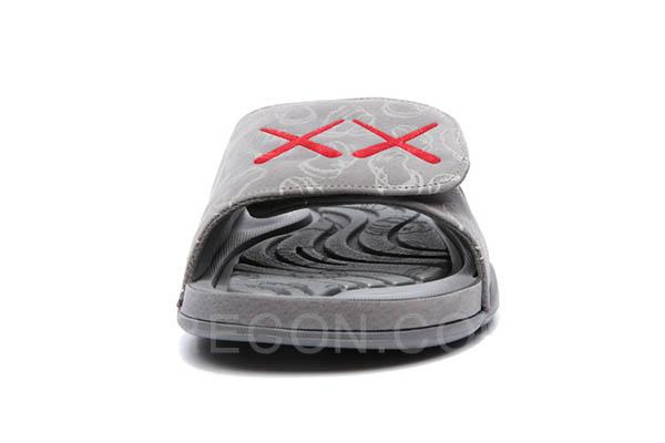 Dép KAWS X Air Jordan 4 Cool Grey Slides